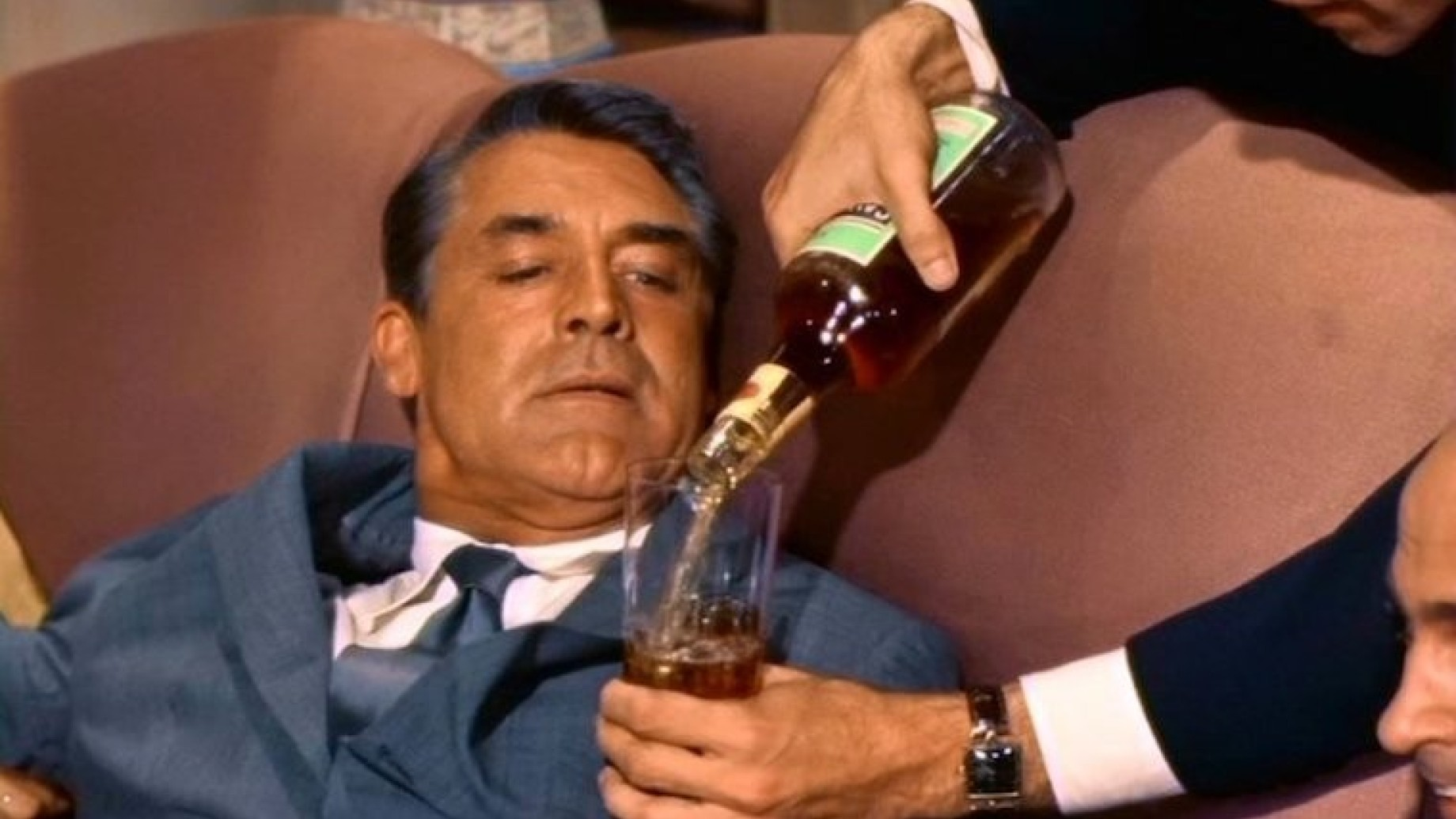 north-by-northwest-1959-001-cary-grant-forced-to-drink-tumbler-full-of-whiskey